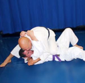 technique genou poitrine nogi jiujitsu knee on belly